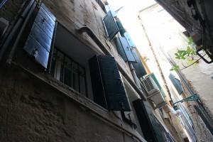 Shutters in alley.